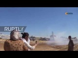 Syria Kobane protesters flee from water cannon as Turks build border wall