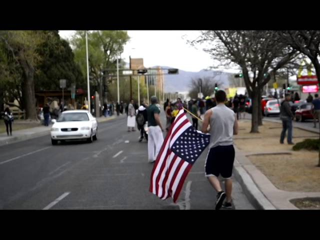 APD Protest A Marine and Soldier Take Back the Flag from Protesters (Inhabitants of Burque)