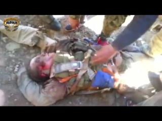 Террористы ИГИЛ глумятся над сбитым Российским лётчиком СУ-24.