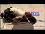 Police officer helps crying mother duck in the city