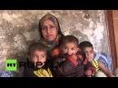 Сирия: Освобожденные Сирийцы описал жизнь под после армии отбить деревню Хомс.