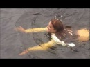 girl jumping into lake fully clothed
