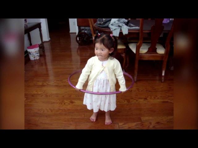 Little Girl Tries to Hula Hoop