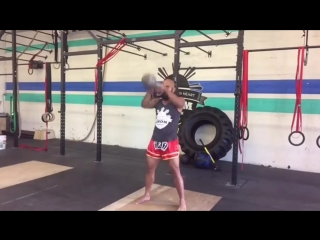 How to Perform an Overhead Kettlebell Swing for Muay Thai