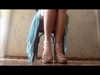 Legs in nude stockings and heels