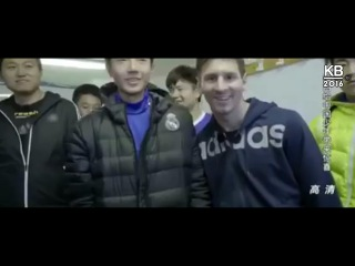Lionel Messi takes a picture with Real Madrid fan