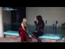 Two girls fully clothed in the pool