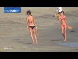 Malibu & Alessandra Ambrosio plays paddle ball on beach in Malibu