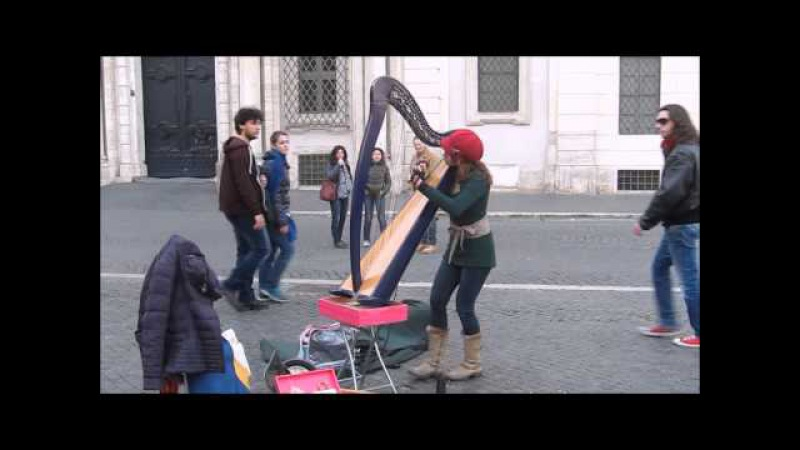 Street artist Harpist plays Yann Tiersen Comptine dun autre été (cover)