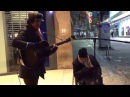 Homeless man joins busker for spontaneous New Year's Eve street jam the result is incredible