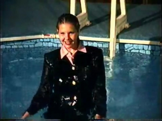 Girl_swims_derssed_in_a_skirt_suit_medium