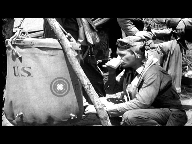 Pilots drink from lister bags and P-40 aircraft land in Bougainville Island. HD Stock Footage