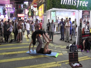 Hong Kong. Street acrobatics.