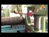 Автоматическая линия для обработки труб с ленточнопильным станком и станком для снятия фаски.