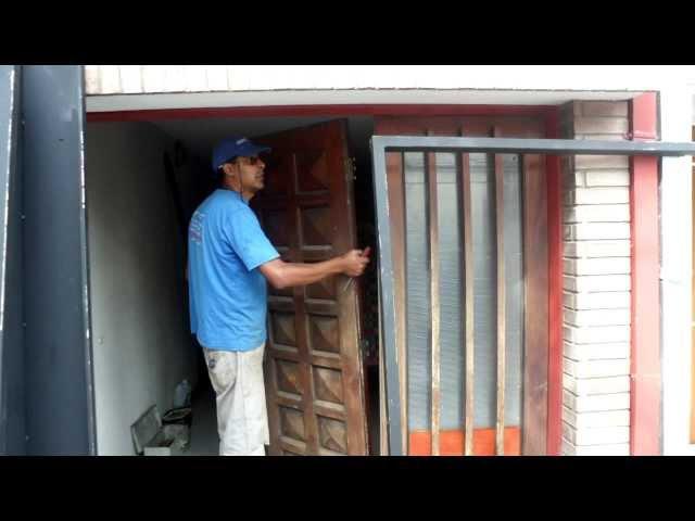 PORTON ADAPTADO A LEVADIZO CON ESPACIO REDUCIDO www.serviport.es.tl