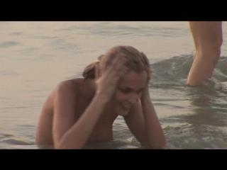 Lesbian babes having fun at the beach