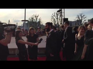 Aidan Turner and his man bun are having a ball on the #BAFTATV red carpet.