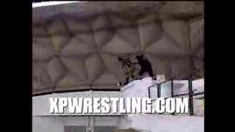 XPW ANGEL Falls Off Building And Misses Tables