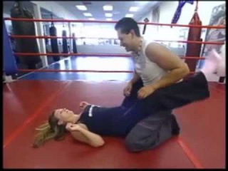man submits to woman, wrestling