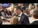 Tom Hiddleston mixing with his fans attending the BAFTAs