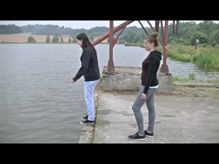 Girl jump into the water fully clothed
