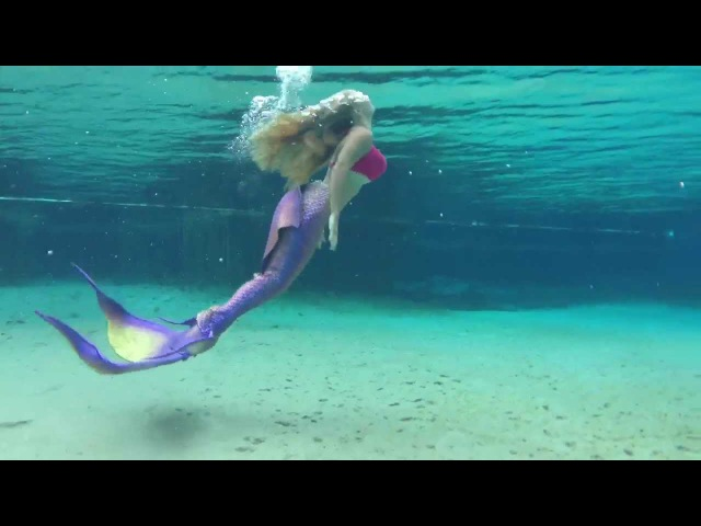 Trina Mason testing out her new Mertailor tail in rainbow s