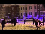 Washington DC police join in a game of football during blizzard