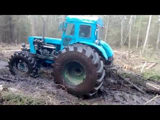 Т 40 на колесах от комбайна работает в болоте