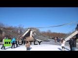 Россия: Лаки побег для пассажиров как мост разрушается в Приморском Крае.