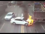 LiveLeak - Car catches fire after hitting two trucks