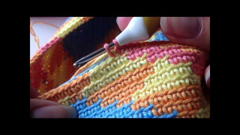 Yarn overyarn under haken - mochila wayuu bag