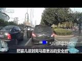 LiveLeak Man saves kitten from under car in busy traffic