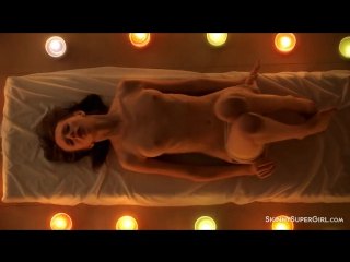 Teen doll Gloria nude in the light of candles