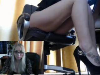 Girl masturbates in front of webcam at work