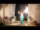 Promo bellydancer Aziza sword wet dancing under the rain