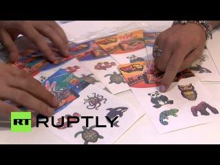Испания: Первые 3Д виртуальные татуировки мировые представила на выставке Мобильный Мир Конгресс.