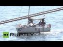 Россия: Яхты и экипаж задержаны Северной Кореи приезжают домой.