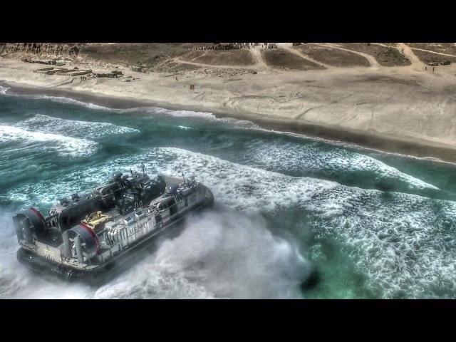 US Military Hovercraft LCAC Assault Amphibious Vehicle Beach Landing Aerial View