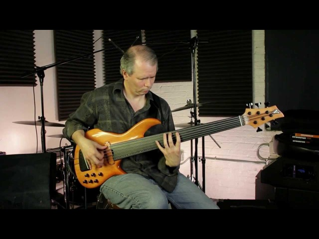 Kevin Woods plays an F Bass vintage fretless BNF-6