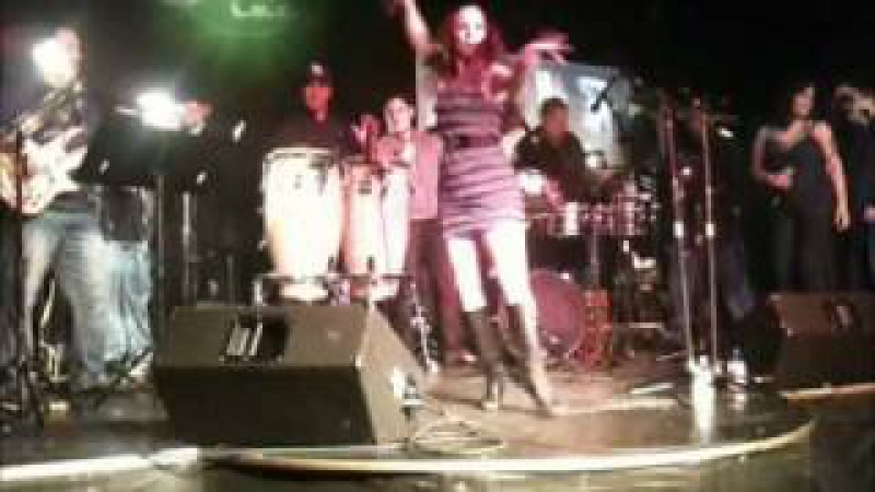 Erika Caliente on stage with Frankie Negron