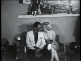 Marilyn Monroe and Arthur Miller july 1956 at idlewild airport