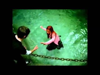 Girl gets wet, fully clothed.
