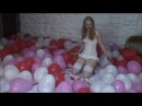 LOONER GIRL POPPING RED AND WHITE BALLOONS