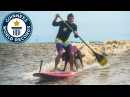 Human and dog paddleboarding - Guinness World Records