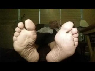 Footboss Relaxes with his Feet in your Face. Dress Socks & Bare Soles.