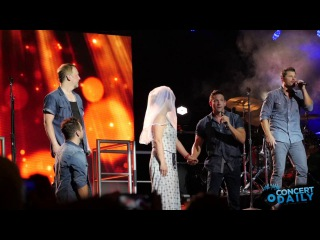 98 Degrees pulls fan on stage performs