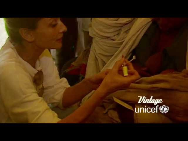 1988 April UNICEF - Audrey Hepburn administers a polio vaccination on a mission to Ethiopia