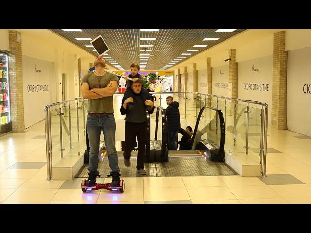 Мальчик разбил iPad Holding the iPad's the balance he rides a Hoverboard