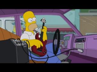 Гомер Симпсон играет на бас-гитаре.