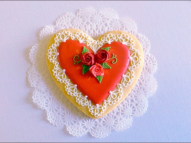 Lace heart cookie with icing roses